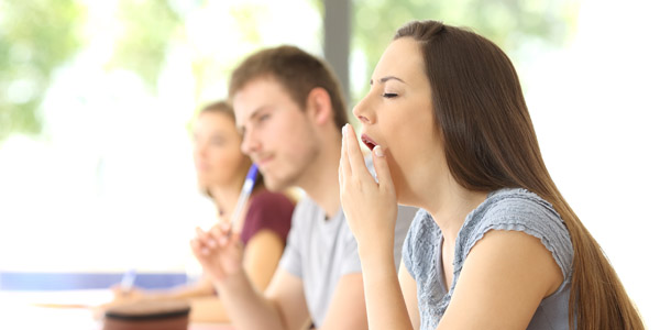 Student Yawning During A Class At Classroom